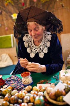 Sigrid Bolduan from the village Klein Loitz, wearing a traditional Lusatian sorbian folk dress, paints an Easter egg in traditional Sorbian motives at the annual Easter egg market on March 24, 2012 in Schleife, near Hoyerswerda, Germany.