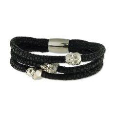 Pulsera de acero y tiras de cuero trenzado negro,con colgantes en cadaveras de Liska. http://relojesplatayacero.com/