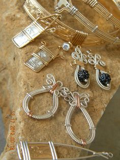 Handwrapped originals -made with 14kt artistic wire (gold and rose) and Sterling silver