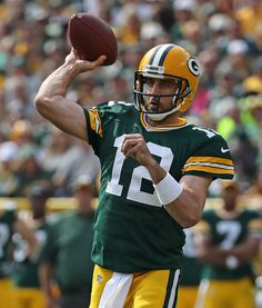 Aaron Rodgers Photos Photos - Aaron Rodgers #12 of the Green Bay Packers throws a first quarter touchdown pass against the Detroit Lions at Lambeau Field on September 25, 2016 in Green Bay, Wisconsin. - Detroit Lions v Green Bay Packers