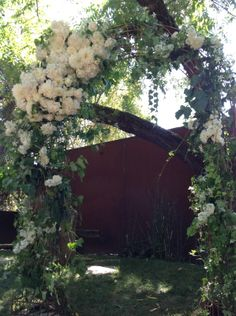 Ceremony arch / chuppah at Barndiva by Dragonfly.  I like the placement of the flowers and the greenery.  But would want the more colorful flowers to match bouquets and table arrangements.