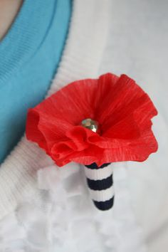 DIY Crepe Paper Poppies for Memorial Day: It means long car trips to the cemetery with the fam to put flowers on Grandpa's grave (as well as other family members we remember and honor on this day).