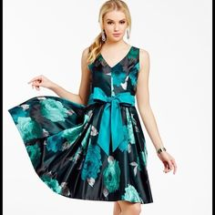 """Metallic Jacquard Fit & Flare avail till 5/23 Lustrous floral jacquard saturated with blue and silver blooms. Oversized bow sash is removable. This dress even has pockets! Fully lined (in the same color fabric as the sash), tulle underlay at hem, dry clean only. Measurements for a 12p; bust 38.5"""", waist 31.5"""", hips 41.5"""", length 36"""". Eliza J Dresses"""