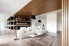 Waterfall effect of wood on the ceiling and walls.  Enlightening White-and-Wood Spaces