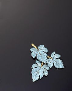 A matched suite of mid 19th century turquoise set ivy leaf shaped jewellery