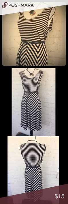 "Calvin Klein sleeveless striped jersey knit dress Look professional -- feel comfortable! Soft, stretchy t-shirt knit dress in cream and black stripes. Waist: 31"" plus stretch. Skirt length: 25"" from waist. Belt not included. Calvin Klein Dresses Midi"