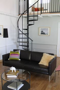 13 Stair Design Ideas For Small Spaces // The thin spiral staircase leading up to the bedroom of this house compliments the other black elements in the home and takes up very little space. Narrow Staircase, Loft Staircase, Modern Staircase, House Stairs, Staircase Design, Stair Design, Spiral Staircases, Spiral Stairs Design, Traditional Staircase