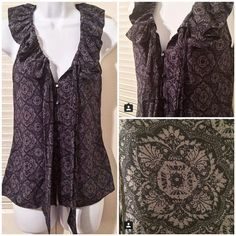 Banana Republic silk, sleeveless button-up blouse Banana Republic silk, sleeveless button-up blouse with matching tie. Navy with a lovely, neutral, gray pattern. So perfect! 100% silk. Size XS. EUC. Banana Republic Tops Button Down Shirts