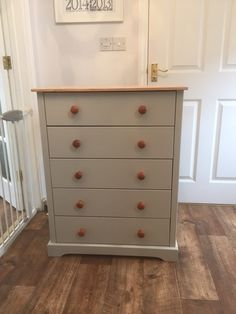 Chest of drawers painted in olive green with natural sanded top