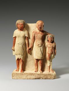 Statue of two men and a boy that served as a domestic icon  Date: ca. 1353–1336 B.C.  Accession Number: 11.150.21
