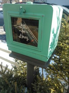 Little free library made from an antique bread box