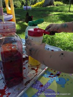 DIY Paint Squirt Bottles....great for toddler fine motor skills and messy play outside!