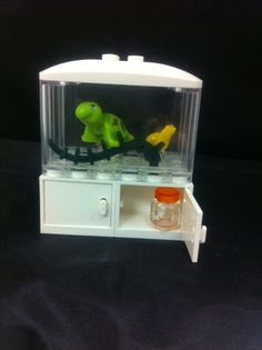 Just made this adorable Lego fish tank. Even has a jar of fish food in the cupboard.