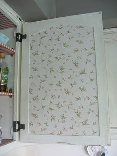 What a neat touch!  Reminds me of Grandma's kitchen & not to forget to decorate the inside of the cabinet doors!