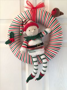 Knitted christmas elf wreath with robin and holly 2016 by helen cole