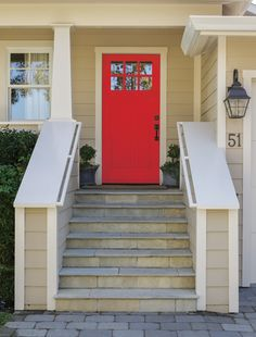 Red is a classic, welcoming hue for a front door, and this cheerful crimson perfectly accents this Craftsman-style home's neutral colors. Shown here: Kelly-Moore Rebel Red Front Door Design, Craftsman Style Homes, Building Exterior, Entrance Doors, Do It Yourself Home, House On Wheels, Old Houses, Neutral Colors, Future House