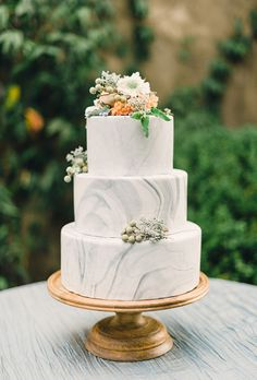 Brides.com: . If you're skeptical about a grey-colored wedding cake, this gorgeous design by Kathryn Steed of Lush Cakery will prove you wrong. To create the lovely marbled tiers, Kathryn combined white fondant and dark grey fondant, which resulted in a soft, rippled effect as the colors intertwined. $5.50 per slice, Lush Cakery