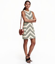 Fitted, sleeveless dress in texture-weave fabric with a graphic pattern. Seam at waist and visible back zip. Lined.