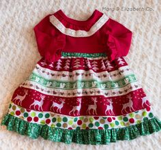 Our Reindeer Christmas Dress is the perfect dress for your Christmas activities! With a gorgeous red knit top and festive dress skirt it gives the right amount of twirl for the Holiday Season!  Sizes available Newborn to 8 Yrs. Dress can be personalized with any fabric or color themes! Please let me know if you would like something special made!  Please Note: all items are handmade by myself. Each item and size measurements may slightly vary. Please know my heart is to provide the best…