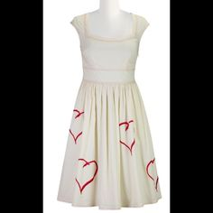 """New Eshakti Fit & Flare Heart Dress L 14 New Eshakti heart embroidered fit & flare dress Size 14 Measured flat: underarm to underarm: 38"""" Waist: 34"""" Length: 40""""  Eshakti size guide for bust 14: 40"""" Rounded square neck, raglan cap sleeves, inner bra strap keeps. Bust darts to shape. Gathered wide banded waist, full skirt, partial side zip closure. Side seam pockets. Lined in cotton voile. Cotton, woven poplin, pre-shrunk and bio-polished, no stretch, mid-weight. Machine wash eshakti Dresses"""