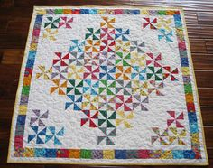from http://www.quiltingboard.com/pictures-f5/bright-baby-quilt-t134673.html