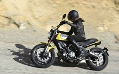 I think this could be the one. But in red of course. 2015 Ducati Scrambler Icon