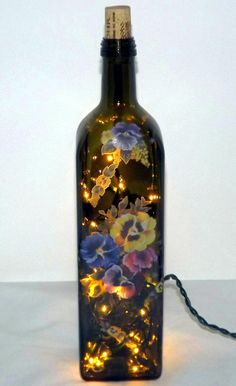 what a cool thing to do with old wine bottles, stickers or fabric, and Christmas lights!