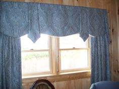 Guest Room windows dressed in a beautiful soft cornice with panels on each side.