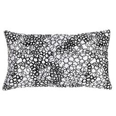 Jiti White & Black Faux Silk Rectangle Pillow - Hundreds of black bubbles on a white background, and an appearance of fine silk, make the Jiti White & Black Faux Silk Rectangle Pillow a designer-qua...