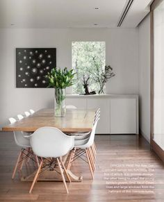White Eames chairs with timber dining table - these chairs are easy to clean but may be a little tippy