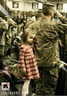 Sweet! saluting behind daddy