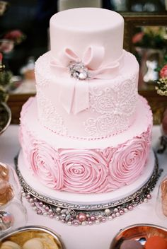 There are many ways to rock a pink wedding cake. While you could have an entirely pink cake, you could also do something a bit more subtle. Fancy Cakes, Cute Cakes, Pretty Cakes, Pink Cakes, Beautiful Wedding Cakes, Gorgeous Cakes, Dream Wedding, Spring Wedding, Bow Wedding