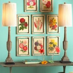 Oh my freaking goodness! I love the colors in the framed pictures with the wall color! They go so well together :)