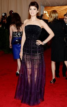 Loving this Dior strapless - the fitted bodice with subtle windowpane texture and sheer purple skirt - stunning- donned by the lovely Marion Cotillard at the Met Costume Gala.