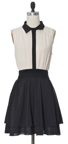 Sleek yet girlie tux style dress. The tiered ruffle skirt bottom adds a playful look to the tailored sleeveless top. Smack on some red lipstick and silver arm candy