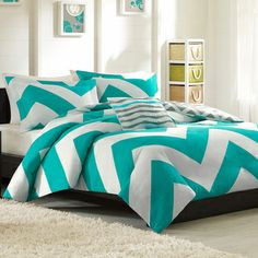 @Overstock.com - Mizone Aries Reversible Peach Skin 4-piece Duvet Cover Set - The Aries Duvet Cover Collection can update the look and feel of the bedroom room instantly. A bright teal and white chevron design on one side and a scaled-down grey and white chevron reverse catches the eye instantly.  http://www.overstock.com/Bedding-Bath/Mizone-Aries-Reversible-Peach-Skin-4-piece-Duvet-Cover-Set/8437461/product.html?CID=214117 $39.99