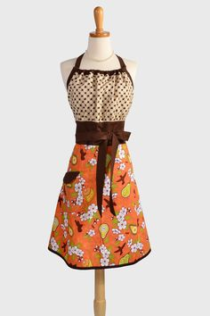 Cute Kitsch Retro Apron : Full Kitchen Womens Apron Handmade in Modern Design in Fall Color Pear Blossoms Orange Fall Thanksgiving Apron. $35.00, via Etsy.