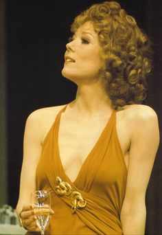 """Diana Rigg, braless as usual when not shooting The Avengers, shows her square shoulders as Célimène in """"The Misanthrope. Emma Peel, The Avengers, Evil Under The Sun, Diana Riggs, Orange Gown, Dame Diana Rigg, George Lazenby, Joanna Lumley, Anos 60"""