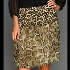 Gorgeous authentic skirt - new with tags - retails for $99 plus tax - beautiful sheer double layered light weight animal print skirt with drawstring waist - drawstrings tie ends have gold tips