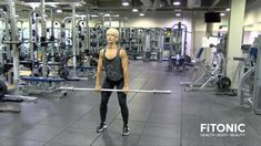Hold the barbell with arms straight and keep a slight bend in the knees. Your fingers should be facing the floor and back straight. While bending the knees, jerk the bar upwards and rotate hands so that palms are facing forward. As you lift the bar to y Six Pack Abs Diet, Six Abs, 6 Pack Abs Workout, Bar Workout, Barbell Workout For Women, Abs Workout For Women, Powerlifting Women, Get Ripped Fast, Hang Clean
