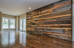 reclaimed wood feature wall behind entertainment center