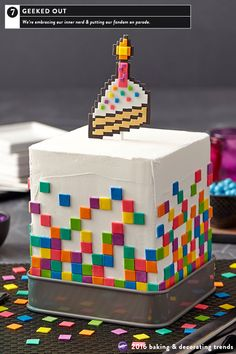 If you geek over video games, sci-fi, or your favorite comic book characters, the Geeked Out cake trend is for you.  This square cake with its pixelated side pattern and cake topper is easy enough for beginners to make, using Decorator Preferred White Fondant and Ready-to-Use Gum Paste tinted to a galactic vibrant color palette.