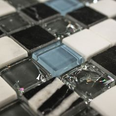 Glass and stone tile for Bathroom redux--good mix of greys, white, black and blue.