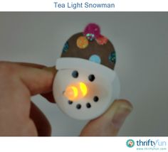 The flame of the battery operated tea lights make a perfect carrot nose for a snowman. With a few supplies you can make an adorable ornament!