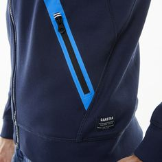 Made of soft sweatshirt material and featuring a detachable hood, this jacket is not only a practical companion for keeping warm on cooler summer days, but is also extremely tasteful. With a sporty design and logo appliqué details on the chest and sleeves, this jacket can be combined with a wide range of different outfits.