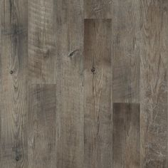 "With its handsome graining, realistic knotholes, and worn saw marks, Dockside is a reclaimed and restored wood visual.  Dockside is available in a larger 6"" x 48"" inch plank and makes a bold statement in design, color, and character."