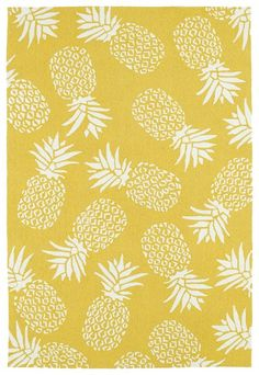Add a sense of the tropics with this warm gold and ivory Pineapple splashed area rug!