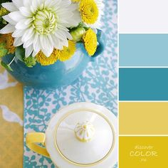 White, muted teal blue, teal, sunflower yellow and mustard Exactly what I want for my kitchen.