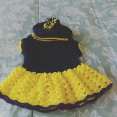 A beautiful baby dress with with  blue trimming and yellow handmade