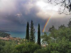 Rainbow in Benitses seaside village, Corfu island, Ionian sea, Greece Places In Greece, Corfu Island, Corfu Greece, Seaside Village, The Great Outdoors, Northern Lights, Saints, Paradise, Greek